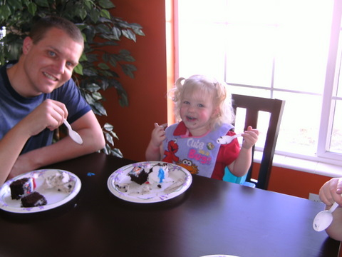 Kennedy eating cake with dad